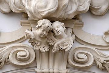 Angels on the portal of Mariahilf church in Graz, Austria
