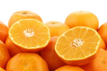 bunch of fresh tangerines and a cut one on a white background
