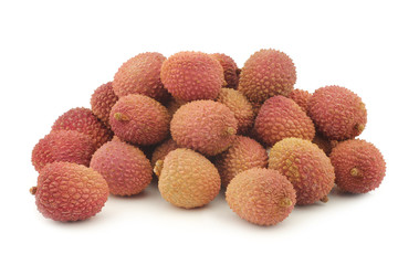 fresh lychees on a white background