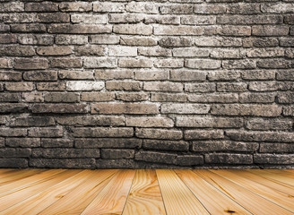 Maple wood floor with old brick wall background