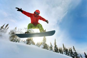 Snowboarder jumping Wall mural
