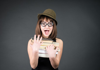 Student in funny glasses with books. Nerd girl studying.