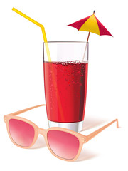 Glass with sunglasses, juice and decorated with a miniature umbr
