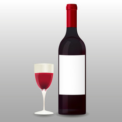 Butelka i lampka czerwonego wina