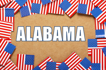 The title Alabama with a border of USA Flags