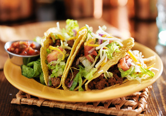 Wall Mural - three beef mexican tacos with cheese and lettuce