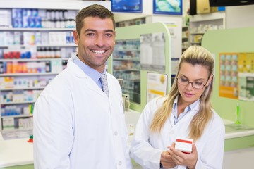 Team of pharmacists looking at medicine