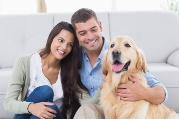 Couple with Golden Retriever in living room