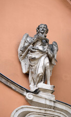Angel on the portal of Holy Trinity church in Graz, Austria