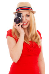 Teenage girl holding a film camera