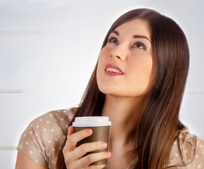 Woman with Coffee in  Cup indoors.