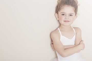 Young ballerina with arms folded
