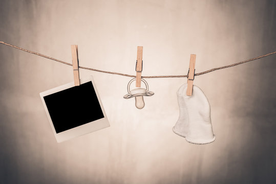 blank instant photo baby stuff  hanging  clothesline