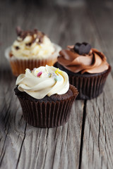 Chocolate cupcake on wooden table