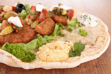 close up on pita bread sandwich