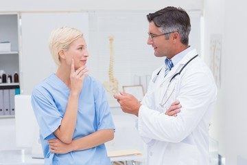 Doctor and nurse discussing in clinic