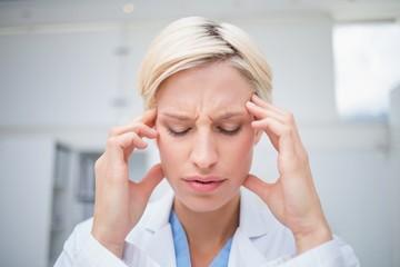 Doctor suffering from headache
