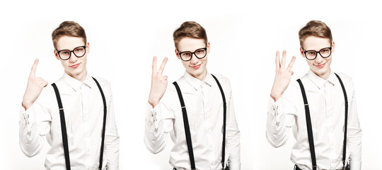 young man shows one two three fingers tripple photo