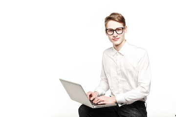 young man in glasses with laptop with emotion
