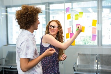 Creative business team pointing at adhesive notes