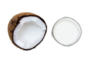 Glass with coconut milk on a white background seen from above