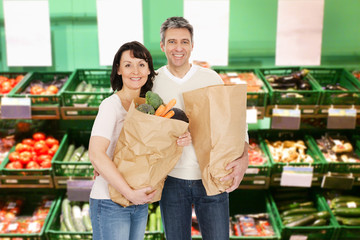 Smiling Mature Couple Holding  Groceries Bag