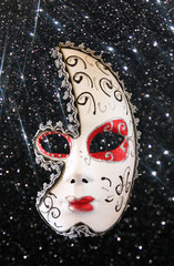 dramatic and mysterious half moon carnival mask and black glitte