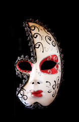 dramatic and mysterious half moon carnival mask isolated on blac