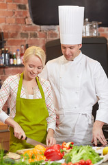 Keuken foto achterwand Keuken happy male chef cook with woman cooking in kitchen
