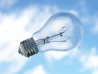 light bulb on blue sky