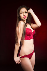 Young girl in red lingerie