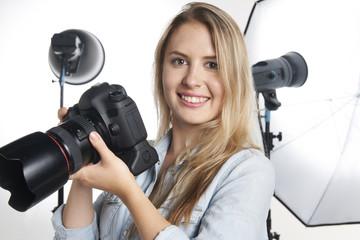 Female Professional Photographer Working In Studio