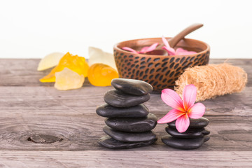 Spa with black stones, seashell shaped soaps and loofah