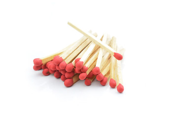 red matches isolated on a white background