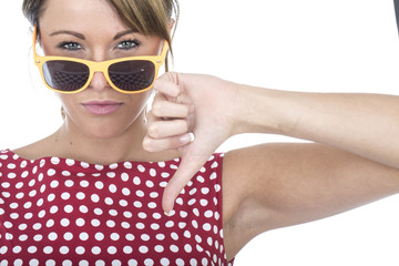 Young Woman Wearing Sun Glasses Thumbs Down