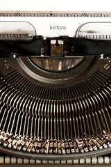 Word RETRO written on an old typewriter