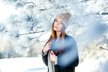 Young, beautiful girl in the winter outdoors. Christmas. Shallow