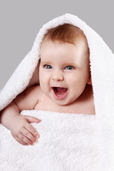 joyful baby in a towel