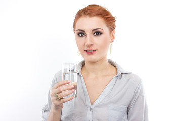 Happy young girl with a glass of water.