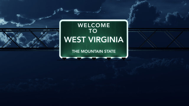 West Virginia USA State Welcome to Highway Road Sign at Night