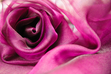 purple cloth folded in the shape of a rose