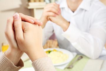 People praying before eating