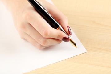 Female hand writing letter