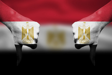 failure of Egypt - hands gesturing thumbs down in front of flag