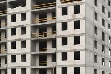 Grey concrete building under construction