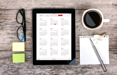 digital tabletdigital tablet as a calendar  and coffee cup wit