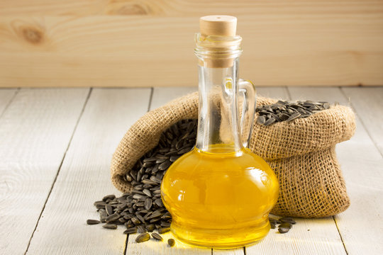 sunflower oil and seeds on wood