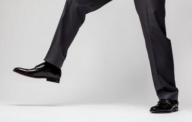 Confident businessman's step