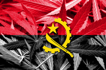 Angola Flag on cannabis background. Drug policy.