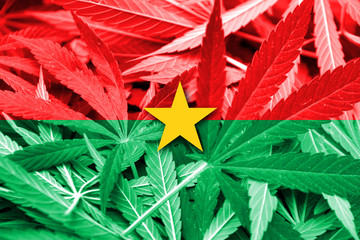 Burkina Faso Flag on cannabis background. Drug policy.